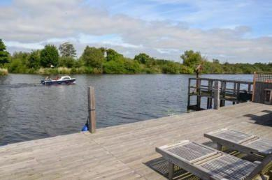 River Yare view from decking at Swallowdale Holiday Home